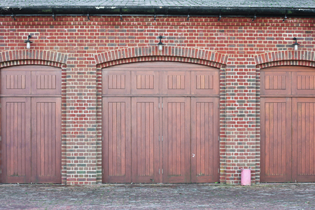 Large wooden doors in a brick building photo
