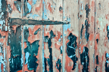 Old wooden door with hinge and peeling paint Stock Photo - 24884413