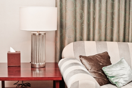 Sofa and table lamp in a sitting room