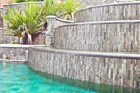 water feature: A water feature in a tropical landscaped garden