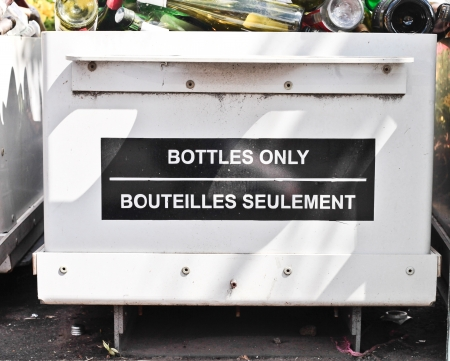 managing waste: A bottle recycling bin at a waste site