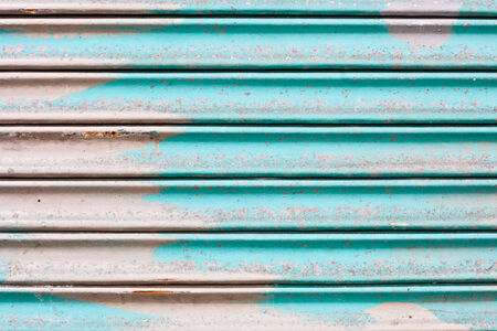 Blue rusty corrugated metal sheet as a background Stock Photo