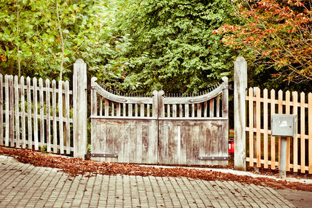 land locked: Wooden gate to a forest park with autumn colors