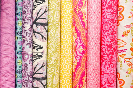 fabric roll: Rolls of colorful fabric as a vibrant background image