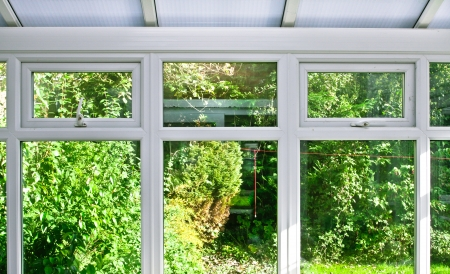 house window: Modern home conservatory windows with garden view Stock Photo