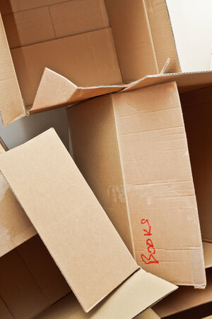 emptied: A heap of emptied cardboard storage boxes