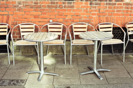 Modern tables and chairs outside a restaurant photo