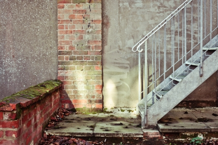 Bottom of a flight of metal stairs Stock Photo - 24884223