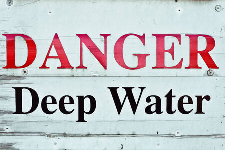 Sign indicating danger from deep water photo