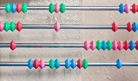 Beads on an abacus as a background image photo