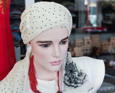 lifelike: A life-like mannequin in a shop window