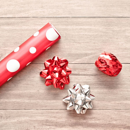 Wrapping paper,ribbon and bows for christmas Stock Photo - 24883972