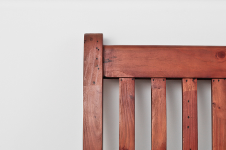 four poster bed: Corner of a wooden bed frame against a white wall Stock Photo