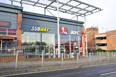 neighbouring: BURY ST EDMUNDS, UK – JANUARY 12, 2014: Neighbouring fast food outlets Subway and KFC on the Parkway. Editorial