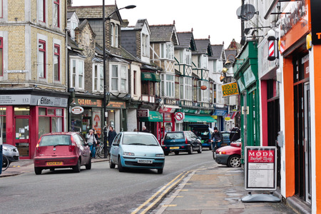 uk cuisine: CAMBRIDGE, UK - JANUARY 25, 2014:  Street scene of Mill Road, Cambridge.  This is street with ethnic shops, and diverse communities.