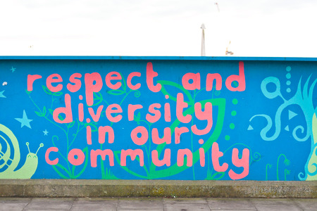 uk cuisine: CAMBRIDGE, UK - JANUARY 25, 2014:  A painted mural on Mill Road, Cambridge, celebrating the diverse community in the area.