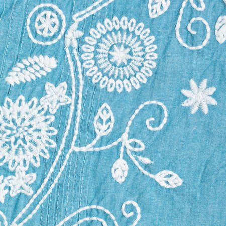 kameez: White embroidered pattern on a blue cotton garment