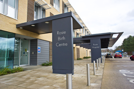 midwifery: CAMBRIDGE, UK - FEBRUARY 18, 2014:  Main public entrance to the Rosie Birth Centre at the Cambridge University Hospital NHS TRust in Cambridge. Editorial