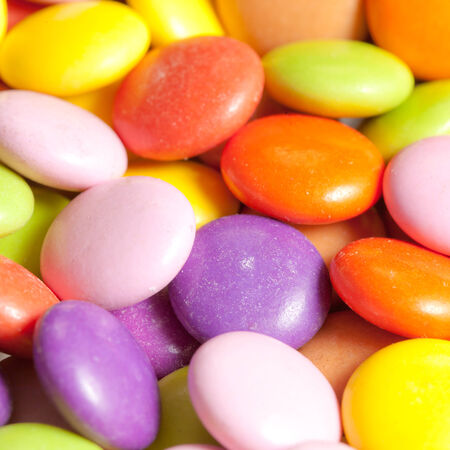 Close up of sugar coated candy with shallow depth of field photo