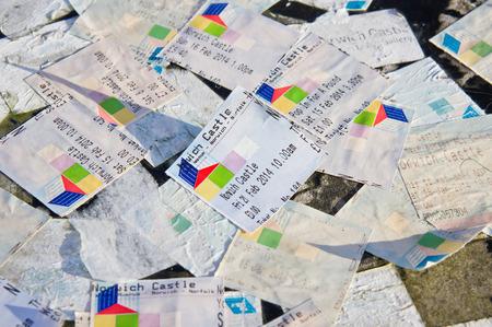 ticket stubs: Norwich, UK- February 21, 2014: Ticket stubs for entrance to Norwich Castle on a rock in Norwich.