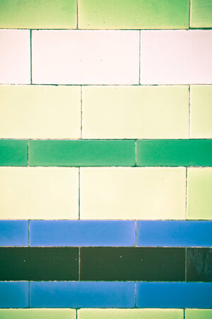 archiitecture: Colorful decorative tiles on an old wall