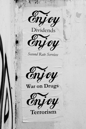 foreign policy: Anti government policy posters in a UK city