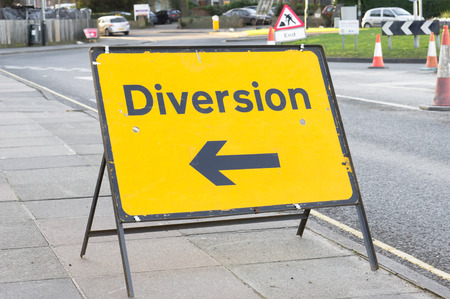 Yellow diversion sign in a UK city street