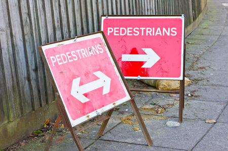 Pedestrain signs on a street in the UK photo