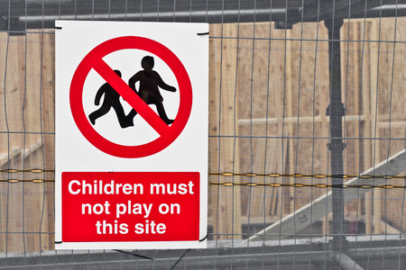 reasons: Sign at a construction site forbidding children for safety reasons Stock Photo