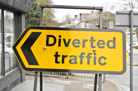 diverted: Yellow diverted traffic sign in a UK town Stock Photo