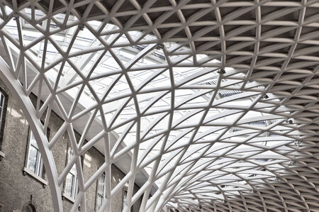 LONDON, UK - FEBRUARY 26, 2014: The ceiling in the refurbished section of Kings Cross Station in London, modernised at the time of the 2012 Olympic Games.
