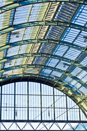 Large arch roof of an old british railway station photo