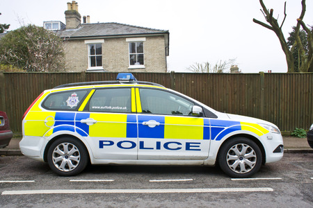 BURY ST EDMUNDS, UK - MARCH 01, 2014: A police car parked on a suburban street in Bury St Edmunds.