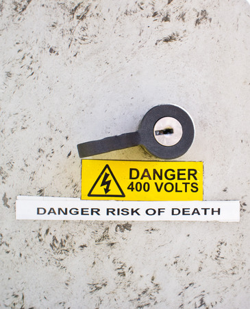 Warning notice for danger of death on an electric supply unit photo