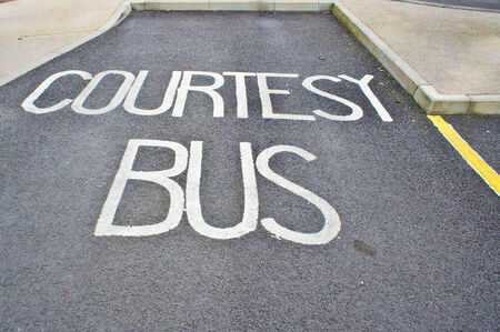 A parking space for a courtesy bus