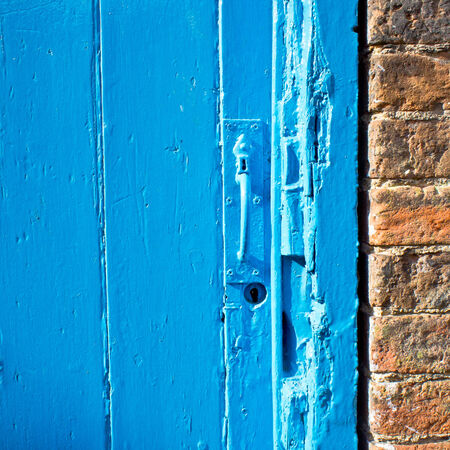Close up of the handle of an old blue door photo