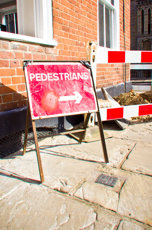 Red notice at a works area indicating a pedestrian route photo