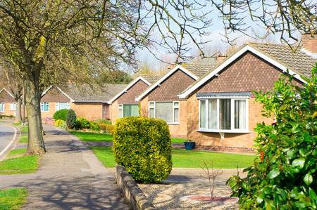 architecture bungalow: Bungalows in a suburban UK neighbourhood in spring Stock Photo