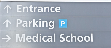 medical school: Grey sign post for a medical school Stock Photo