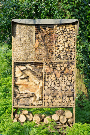 animal den: Storage of wood and straw for fire and gardening Stock Photo