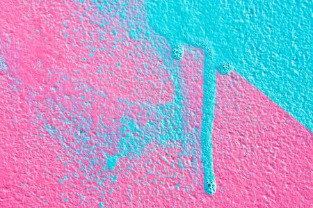 blue paint: Pink and blue paint on a wall Stock Photo