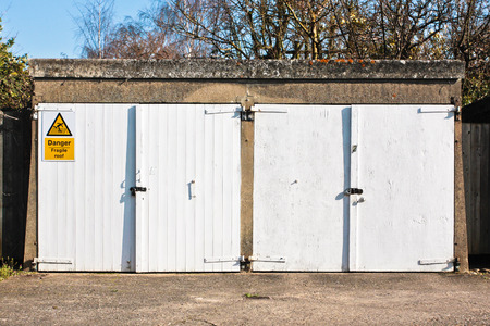 A pair of white wooden garage doors photo