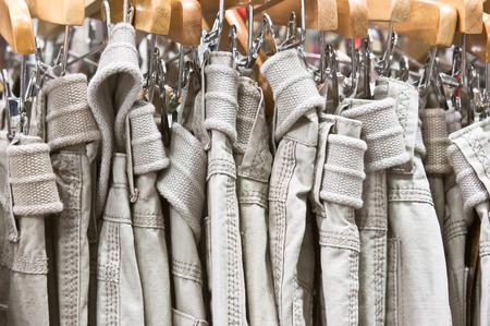 khaki pants: Casual mens trousers in a shop