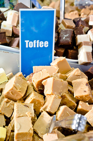 flavored: Display of toffee flavored fudge sweets at a market