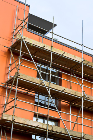 site preparation: Exterior scaffolding on a modern building Stock Photo