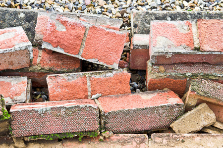carnage: Pile of bricks from a collapsed wall Stock Photo