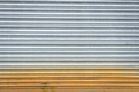 Sheet of corrugated metal with rust as a background photo