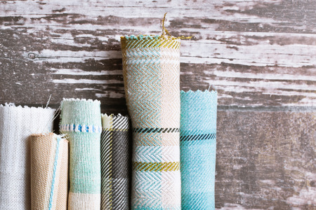 fabric roll: Blue and cream tartan fabric rolls Stock Photo