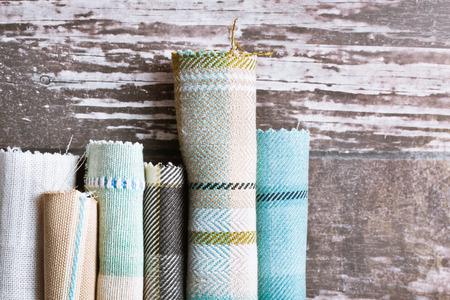 Blue and cream tartan fabric rolls Foto de archivo