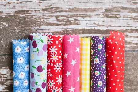 Rolls of colorful patterned fabric